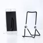 スマートフォンから本まで なんでも立てかけられる汎用性の高いワイヤースタンド
